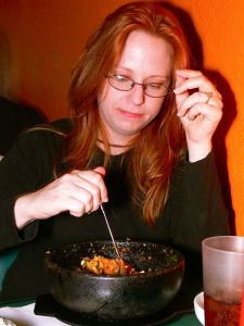 Tammy beams over dolsot bibimbap.