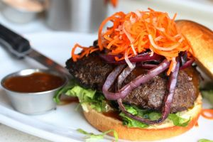 The Korean BBQ burger at The Counter, Corte Madera, tastes more Japanese and Vietnamese with the ginger-forward teriyaki-like sauce and pickled carrot and daikon radish topping. (Jeff Quackenbush photo)